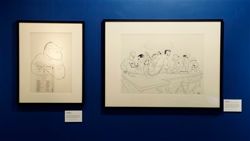 """. Drawings related to the play \""""Men in White\"""" are displayed in an exhibit on artist Al Hirschfeld at the Library for the Performing Arts in New York, Wednesday, Oct. 16, 2013. These drawings were part of a series of Pulitzer Prize-winning plays and their authors. (AP Photo/Seth Wenig)"""