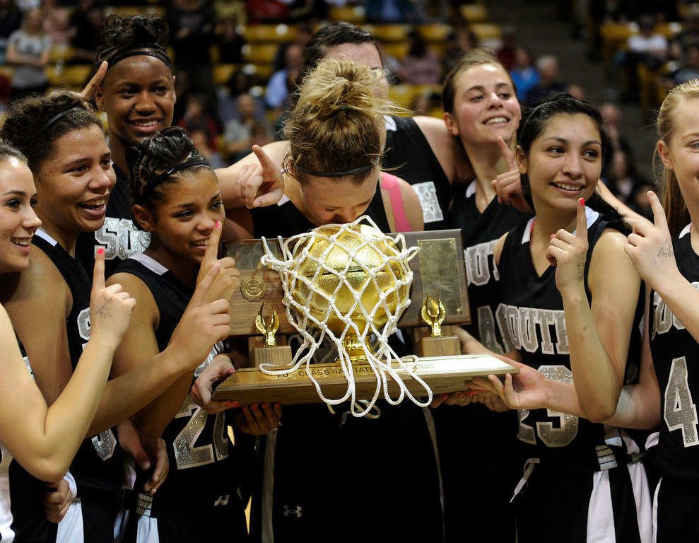 . BOULDER, CO. - MARCH 16: Colts senior Mikala Gordon, center, kissed the trophy. The Pueblo South High School girl\'s basketball team defeated D\'Evelyn 66-42 in the 4A championship game Saturday, March 16, 2013 at the Coors Events Center in Boulder.  (Photo By Karl Gehring/The Denver Post)