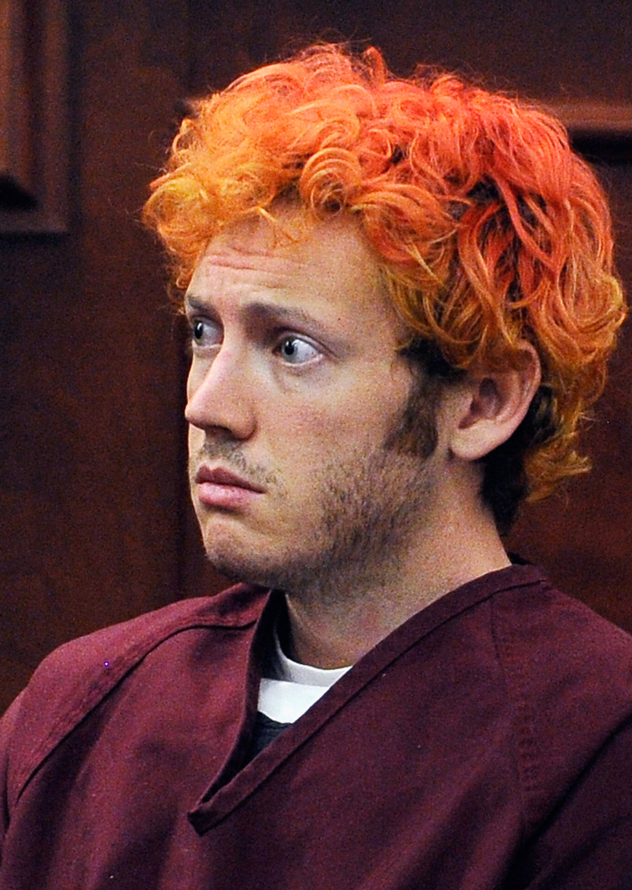 ". Accused movie theater shooter James Holmes makes his first court appearance at the Arapahoe County on July 23, 2012 in Centennial, Colorado. According to police, Holmes killed 12 people and injured 58 others during a shooting rampage at an opening night screening of ""The Dark Knight Rises\"" July 20, in Aurora, Colorado.  (Photo by RJ Sangosti-Pool/Getty Images)"