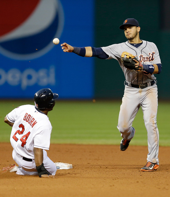 . Detroit Tigers shortstop Eugenio Suarez, right, throws to first base after getting Cleveland Indians\' Michael Bourn out at second base in the sixth inning of a baseball game, Friday, June 20, 2014, in Cleveland. Asdrubal Cabrera was out at first base for the double play. (AP Photo/Tony Dejak)