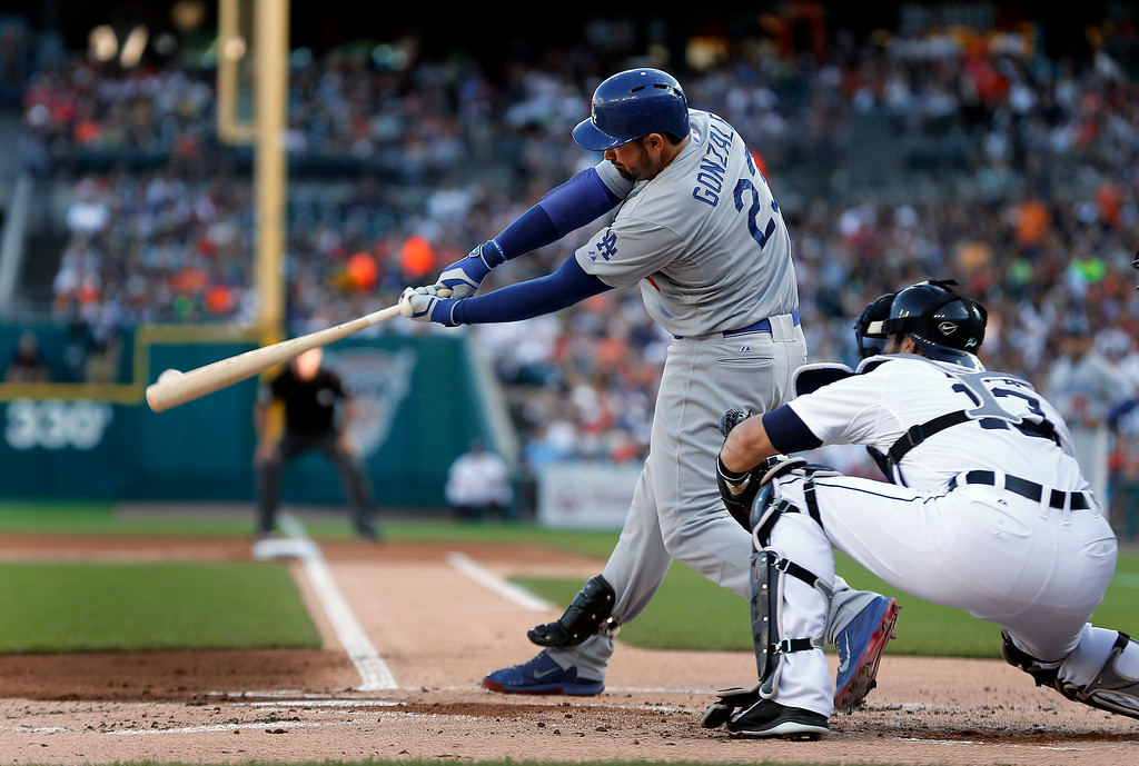 . Los Angeles Dodgers\' Adrian Gonzalez hits a two-run double against the Detroit Tigers in the first inning of a baseball game in Detroit, Tuesday, July 8, 2014. (AP Photo/Paul Sancya)