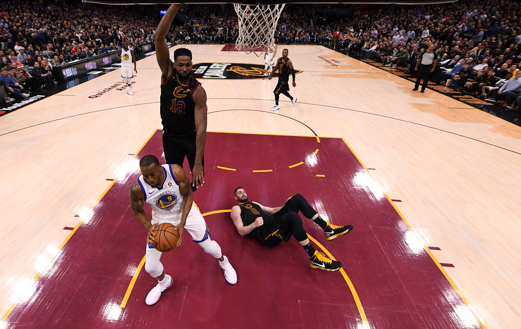 . Cleveland Cavaliers center Tristan Thompson (13) comes down on Golden State Warriors forward Andre Iguodala (9) as Cleveland Cavaliers center Kevin Love (0) hits the floor during the second half of Game 3 of basketball\'s NBA Finals, Wednesday, June 6, 2018, in Cleveland. The Warriors defeated the Cavaliers 110-102 to take a 3-0 lead in the series. (Kyle Terada/Pool Photo via AP)