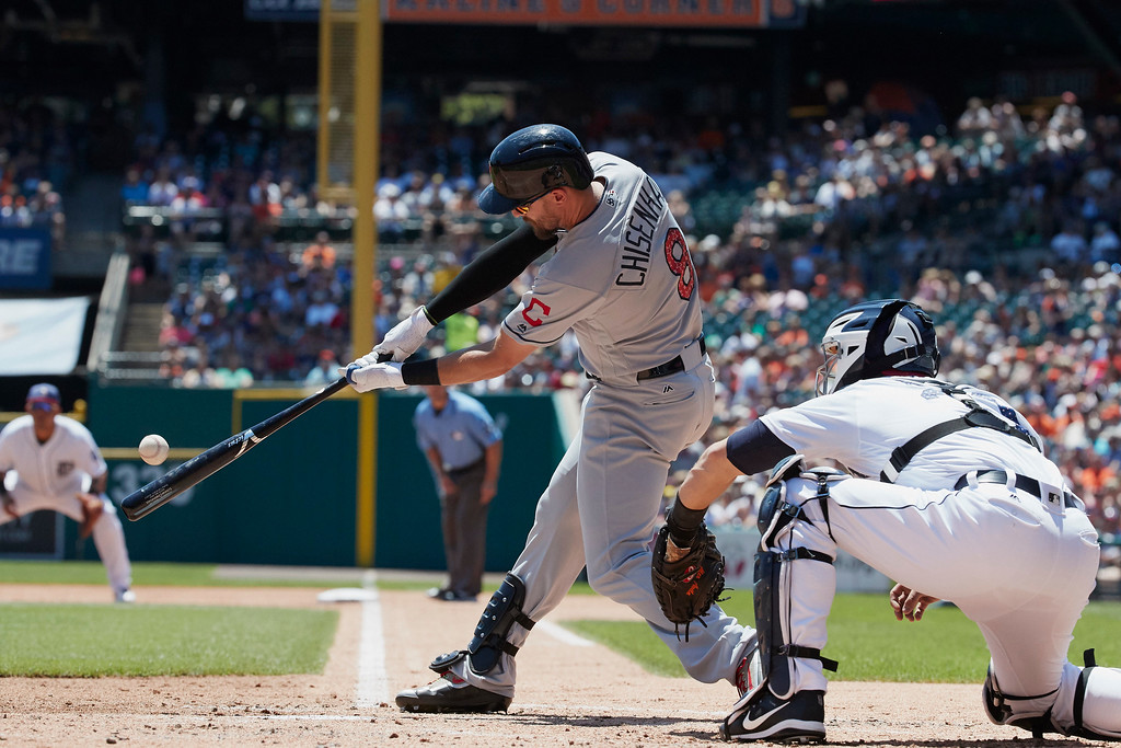 . Cleveland Indians\' Lonnie Chisenhall (8) hits a two-run home run against the Detroit Tigers in the second inning of a baseball game in Detroit, Sunday, July 2, 2017. (AP Photo/Rick Osentoski)