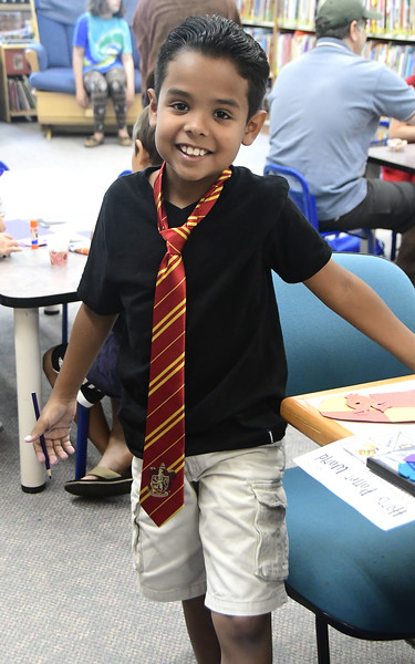 7/31/2018 Mike Orazzi | Staff Yadiel Martinez,9, while celebrating  Harry Potter's birthday during Harry Potter Day at the  Manross Library in Forestville Tuesday afternoon.