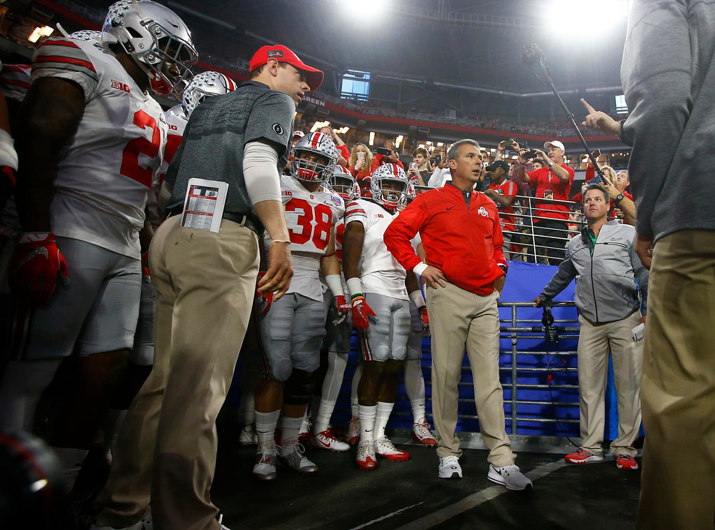 . Ohio State takes the field prior to the Fiesta Bowl NCAA college football game against Clemson, Saturday, Dec. 31, 2016, in Glendale, Ariz. (AP Photo/Ross D. Franklin)