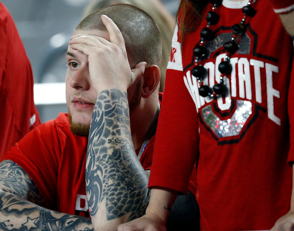 . An Ohio State fan watches during the second half of the Fiesta Bowl NCAA college football game against Clemson, Saturday, Dec. 31, 2016, in Glendale, Ariz. (AP Photo/Ross D. Franklin)