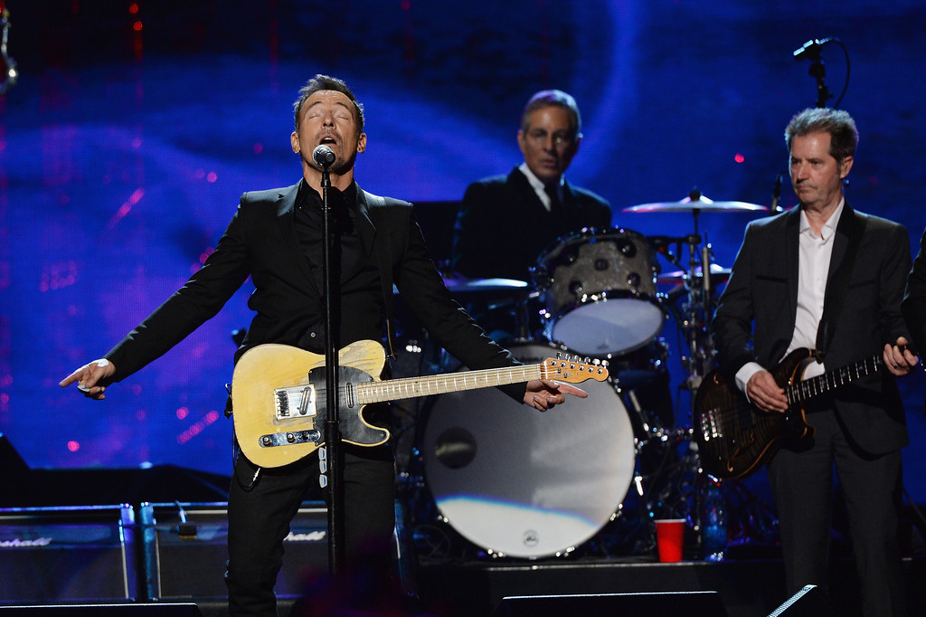 . (L-R) Bruce Springsteen and inductees Max Weinberg and Garry Tallent of the E Street Band perform onstage at the 29th Annual Rock And Roll Hall Of Fame Induction Ceremony at Barclays Center of Brooklyn on April 10, 2014 in New York City.  (Photo by Larry Busacca/Getty Images)