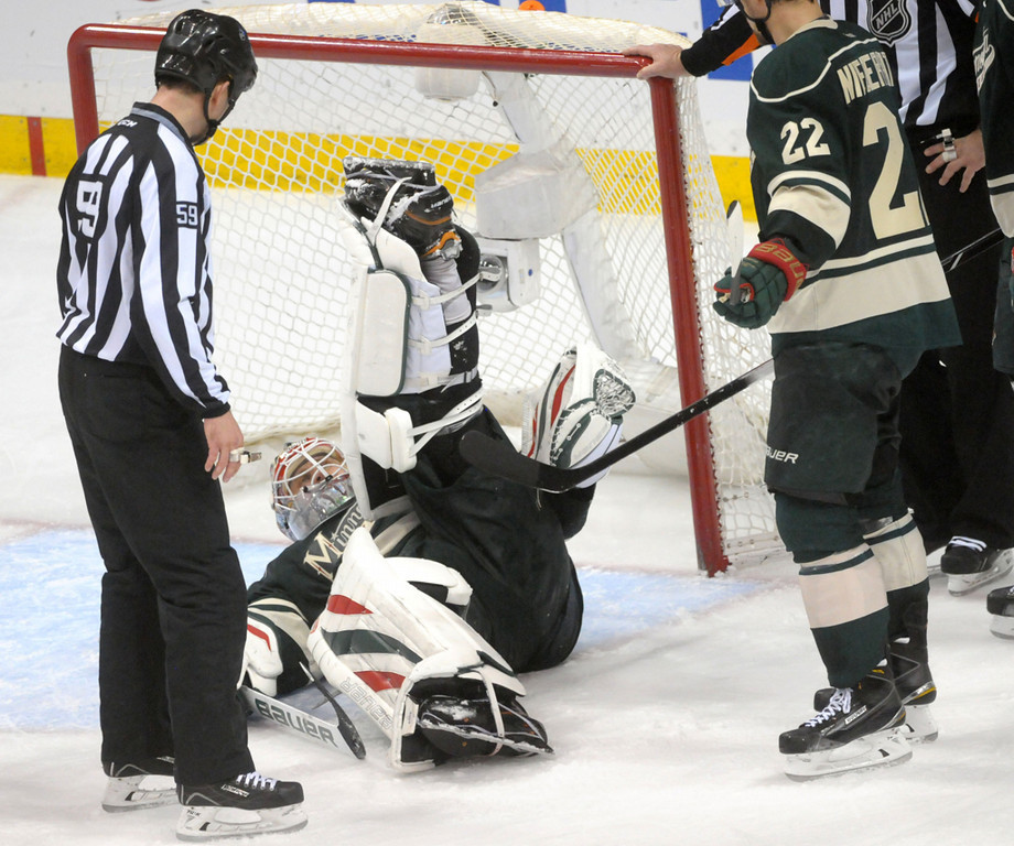 . Minnesota Wild goalie Ilya Bryzgalov shakes a puck out of his goalie gear after a save during overtime.   (Pioneer Press: Sherri LaRose-Chiglo)