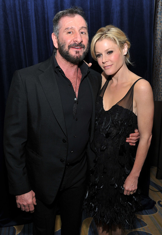 ". Designer Ralph Rucci, recipient of the ""Visionary Award,\"" poses with actress Julie Bowen at the L.A. Gay and Lesbian Center\'s \""An Evening\"" at the Beverly Wilshire on Thursday, March 21, 2013 in Beverly Hills, Calif. (Photo by Chris Pizzello/Invision/AP)"