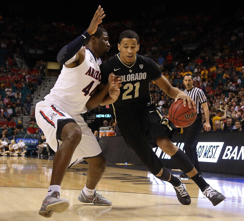 . Andre Roberson #21 of the Colorado Buffaloes drives on Solomon Hill #44 of the Arizona Wildcats in the first half during the quarterfinals of the Pac-12 tournament at the MGM Grand Garden Arena on March 14, 2013 in Las Vegas, Nevada.  (Photo by Jeff Gross/Getty Images)
