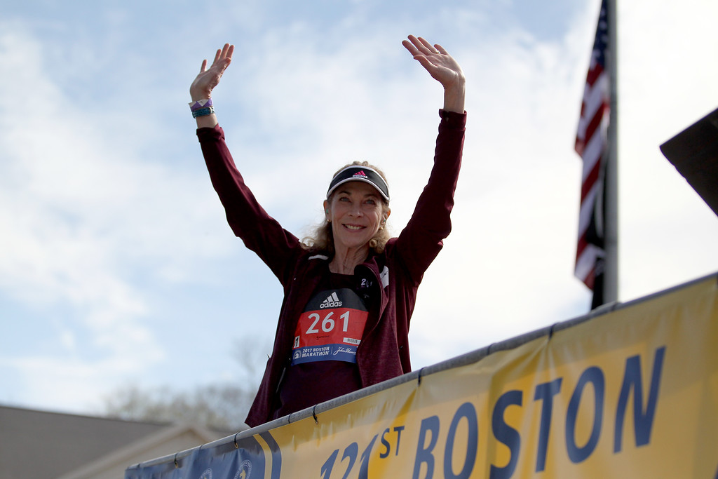 . Kathrine Switzer, who was the first official woman entrant in the Boston Marathon 50 years ago, acknowledges the crowd as she is introduced before firing the gun to start the women\'s elite division at the start of the 2017 Boston Marathon in Hopkinton, Mass., Monday, April 17, 2017. (AP Photo/Mary Schwalm)