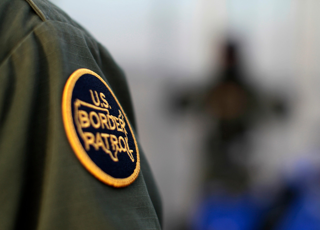 . A  patch is shown on the uniform of a U.S. Customs and Border Patrol agent near the international border between Mexico and the United States south of San Diego, California, March 26, 2013. Picture taken March 26, 2013. REUTERS/Mike Blake