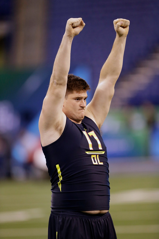 . Indiana offensive lineman Dan Feeney stretches at the NFL football scouting combine Friday, March 3, 2017, in Indianapolis. (AP Photo/David J. Phillip)