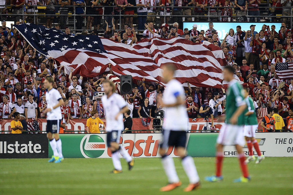 . Fans unfurl a large U.S. flag after the U.S. Men\'s National Team scored their second goal against Mexico in the second half at Columbus Crew Stadium on September 10, 2013 in Columbus, Ohio. The United States defeated Mexico 2-0.  (Photo by Jamie Sabau/Getty Images)