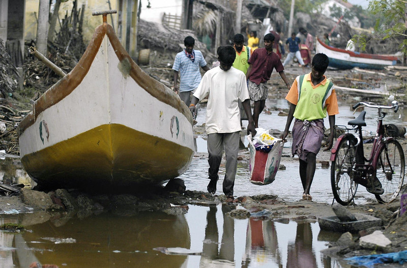 . People leave the devastated Karmavadi village with their belongings in the Nagapattinam district, some 350 km south of Madras on December 27, 2004, after tidal waves hit the region. The death toll in southern India from tidal waves that battered much of Asia crossed 6,800 Monday with thousands still missing, officials said. The official count of 6,823 dead included some 3,000 in the Andaman and Nicobar Islands, close to the epicenter of the Indonesian earthquake that caused the tsunamis, and another 3,600 in the southern Indian state of Tamil Nadu and the former French colony of Pondicherry.       PRAKASH SINGH/AFP/Getty Images
