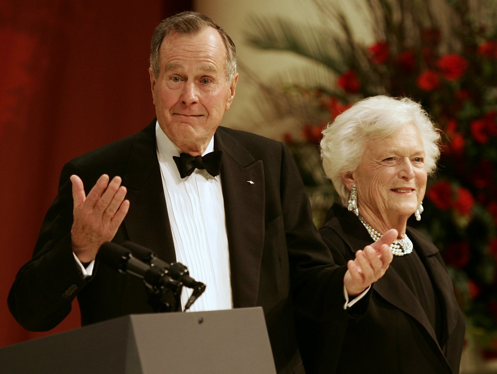 . Former President George H. W. Bush reacts to the crowd with his wife Barbara Bush at the Commander-In-Chief Ball in Washington Thursday, Jan. 20, 2005. (AP Photo/Gerald Herbert)