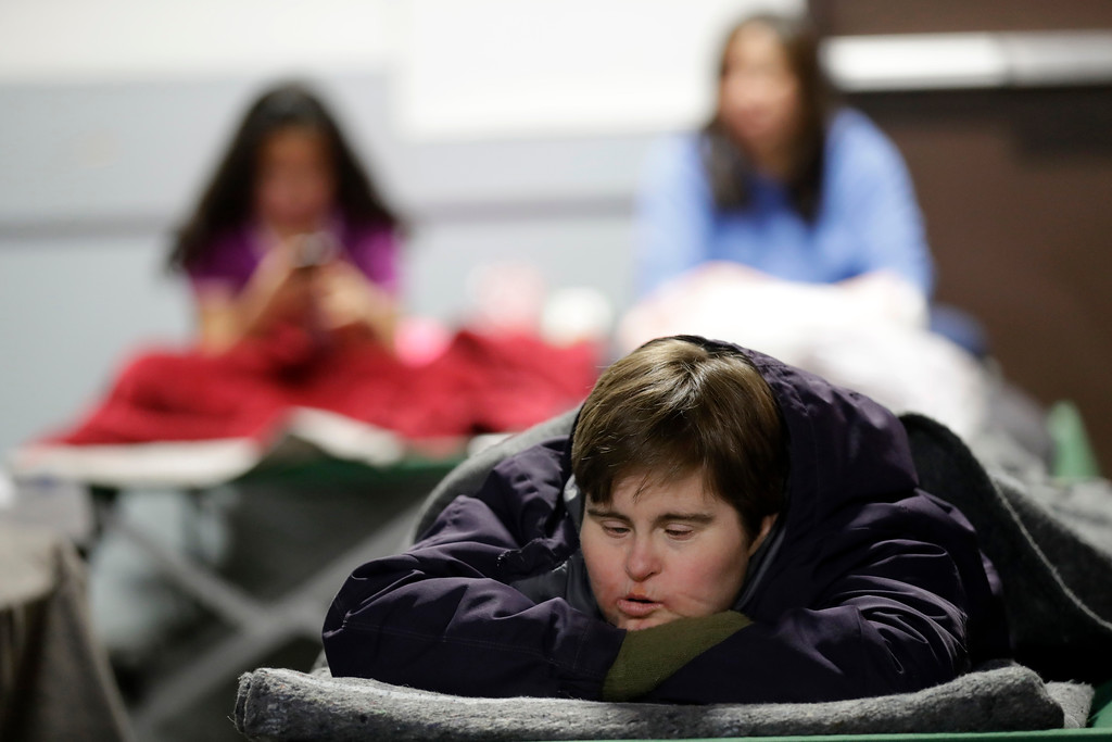 . Sonya Warrick, of Oroville, Calif., rests at a shelter for evacuees from cities surrounding the Oroville Dam, Monday, Feb. 13, 2017, in Chico, Calif. The thousands of people who were ordered to leave their homes after a damaged California spillway threatened to unleash a 30-foot wall of water may not be able to return until significant erosion is repaired, authorities said Monday. (AP Photo/Marcio Jose Sanchez)