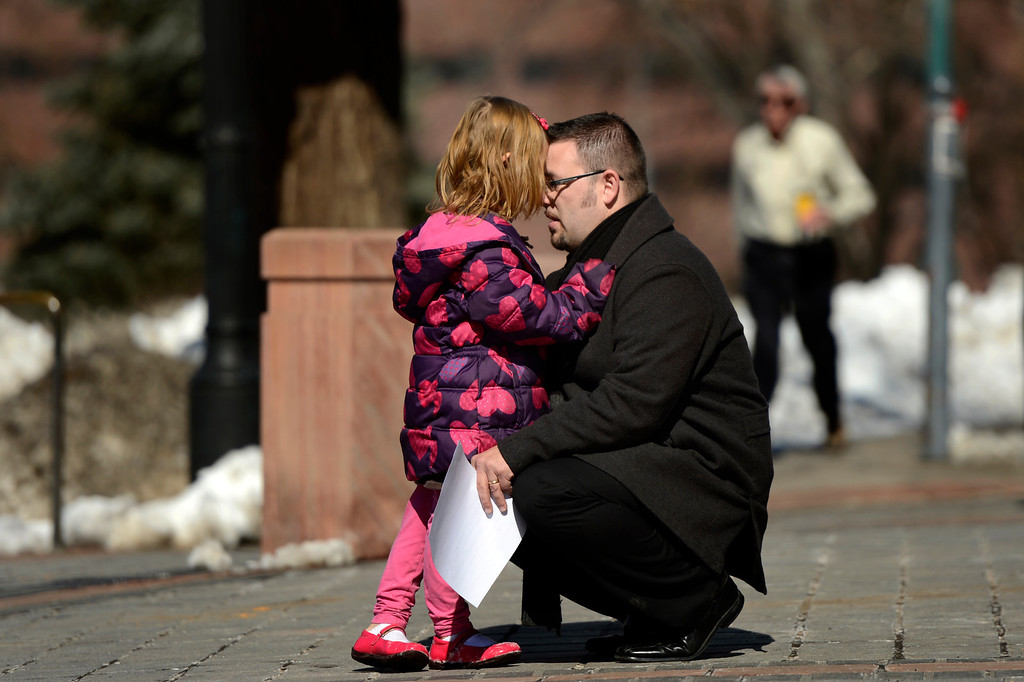 . 6-year-old Coy Mathis talking with her dad Jeremy in front of the Denver State Capitol as her mother Kathryn, is interviewed after their press conference.(Photo By Joe Amon/The Denver Post)