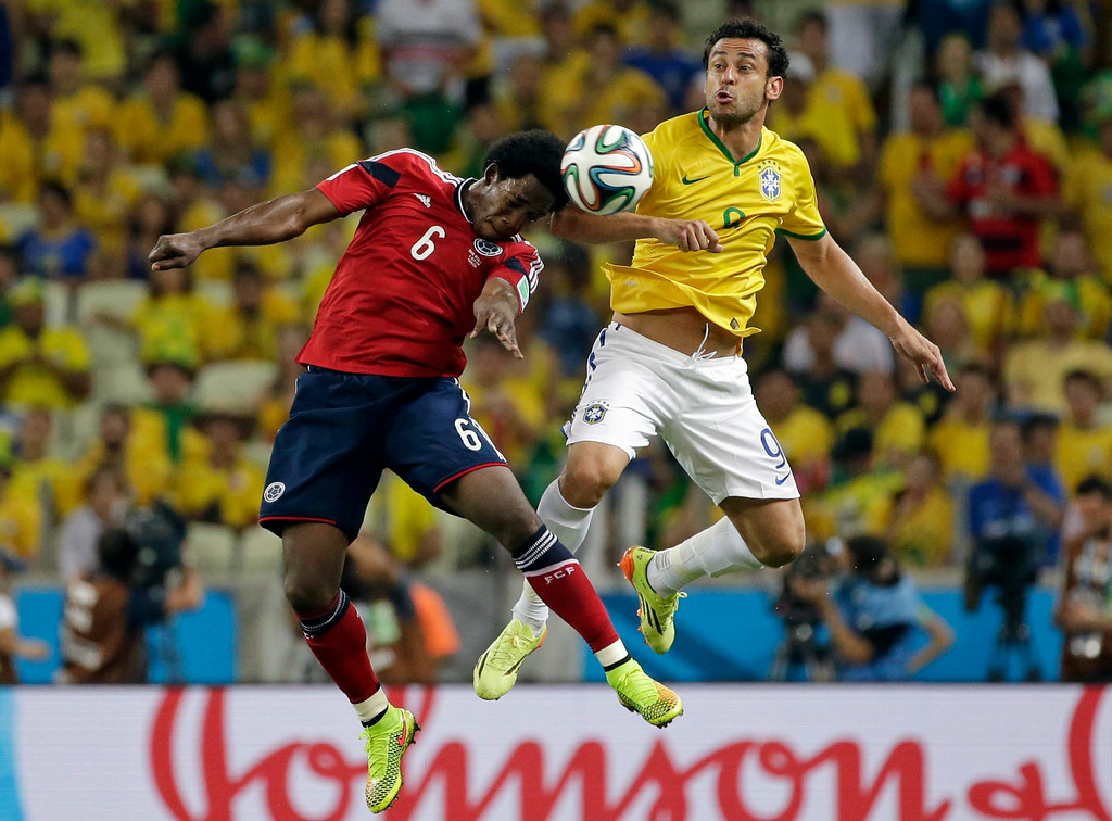 . Colombia\'s Carlos Sanchez Moreno wins a header against Brazil\'s Fred during the World Cup quarterfinal soccer match between Brazil and Colombia at the Arena Castelao in Fortaleza, Brazil, Friday, July 4, 2014. (AP Photo/Felipe Dana)