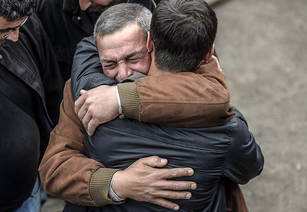 . Two men react after the death of a relative on May 14, 2014 following an explosion and fire in a coal mine in the western Turkish province of Manisa killed at least 201 people and hundreds remain trapped underground.   AFP PHOTO/BULENT  KILIC/AFP/Getty Images