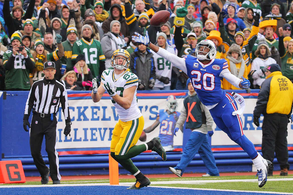 . ORCHARD PARK, NY - DECEMBER 14:   Jordy Nelson #87 of the Green Bay Packers has a reception broken up by Corey Graham #20 of the Buffalo Bills during the first half at Ralph Wilson Stadium on December 14, 2014 in Orchard Park, New York.  (Photo by Brett Carlsen/Getty Images)