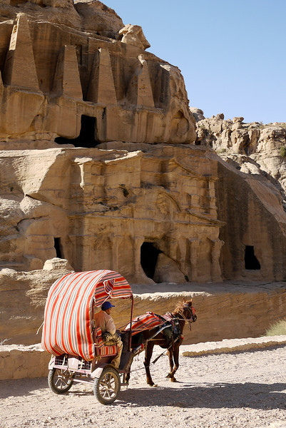 Horse-drawn carriages take tourists deep into Petra, Jordan.