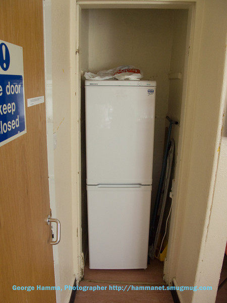 Each kitchen has a small refrigerator/freezer to share and an ironing board.