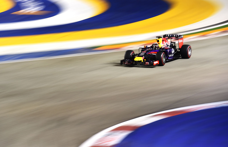 . Sebastian Vettel of Germany and Infiniti Red Bull Racing drives during practice ahead of the Singapore Formula One Grand Prix at Marina Bay Street Circuit on September 19, 2014 in Singapore, Singapore.  (Photo by Lars Baron/Getty Images)