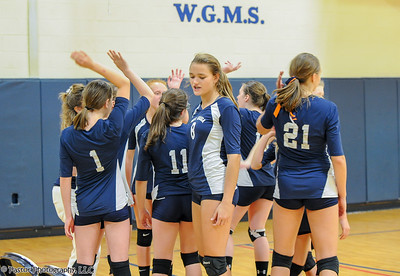 8th Grade Volleyball action