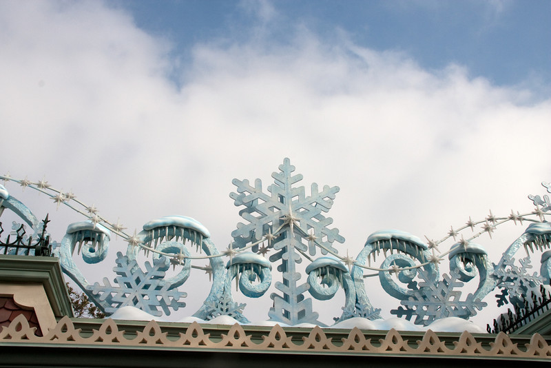 The winter decor over the Disneyland entry gates.