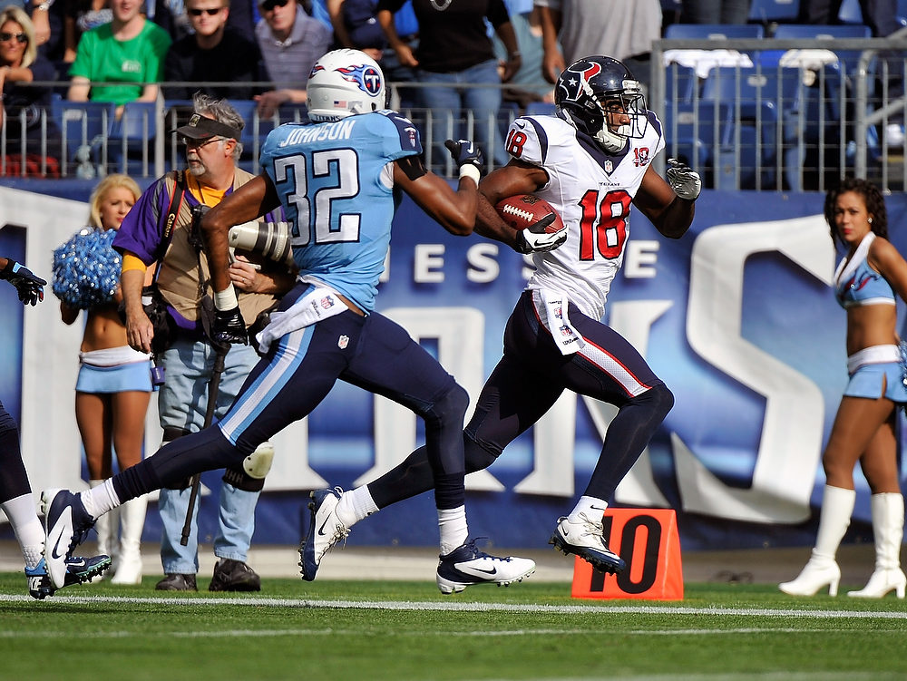 . Robert Johnson #32 of the Tennessee Titans chases Lestar Jean #18 of the Houston Texans as he runs into the endzone for a touchdown at LP Field on December 2, 2012 in Nashville, Tennessee.  (Photo by Frederick Breedon/Getty Images)