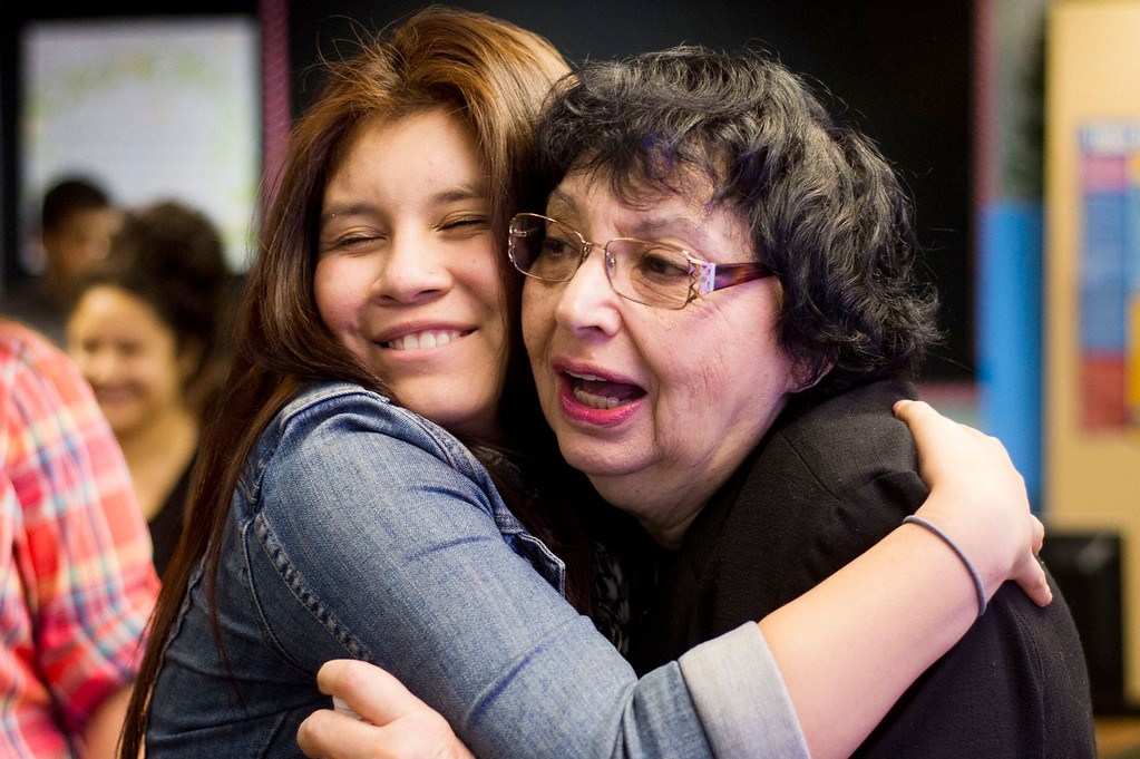 . Inge Auerbacher, 78, one of the Holocaust child survivors, gets a hug from a student after she shared her stories at Sierra High School in Glendora on Tuesday, Nov. 12, 2013. Auerbacher told her stories about the time she spent in the Terezin concentration camp. (Photo by Watchara Phomicinda/San Gabriel Valley Tribune)