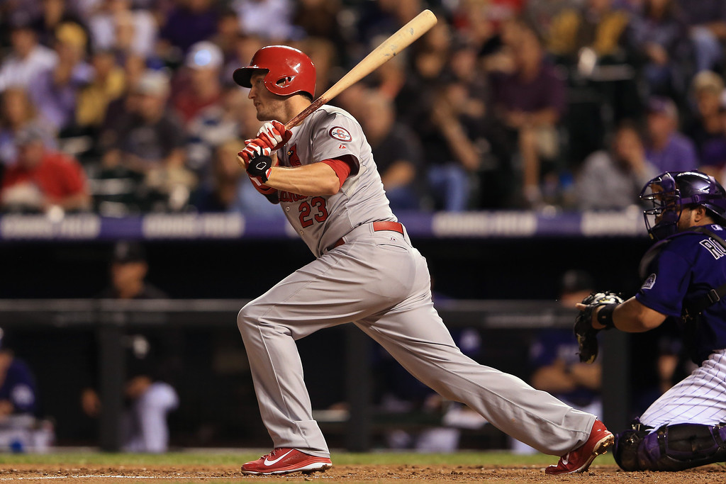 . David Freese #23 of the St. Louis Cardinals hits an RBI single to score Matt Adams #53 of the St. Louis Cardinals to tie the score 1-1 with the Colorado Rockies in the fifth inning at Coors Field on September 16, 2013 in Denver, Colorado.  (Photo by Doug Pensinger/Getty Images)