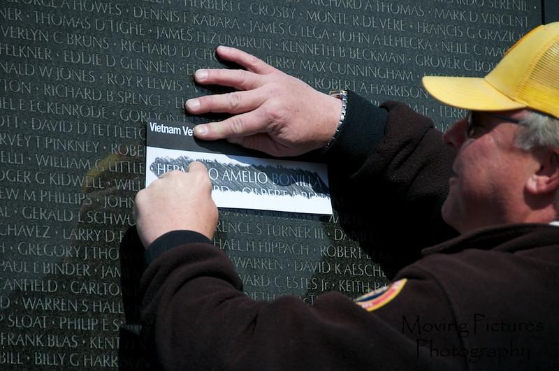 Vietnam War Memorial - Park Service employee making a rubbing