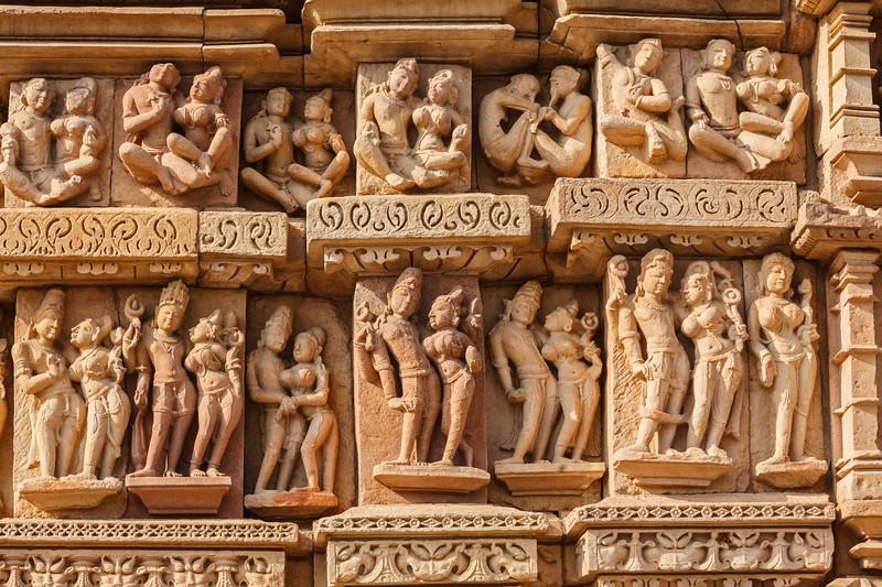 Stone carving bas relief sculptures on Adinath Jain Temple, Khajuraho, Madhya Pradesh, India