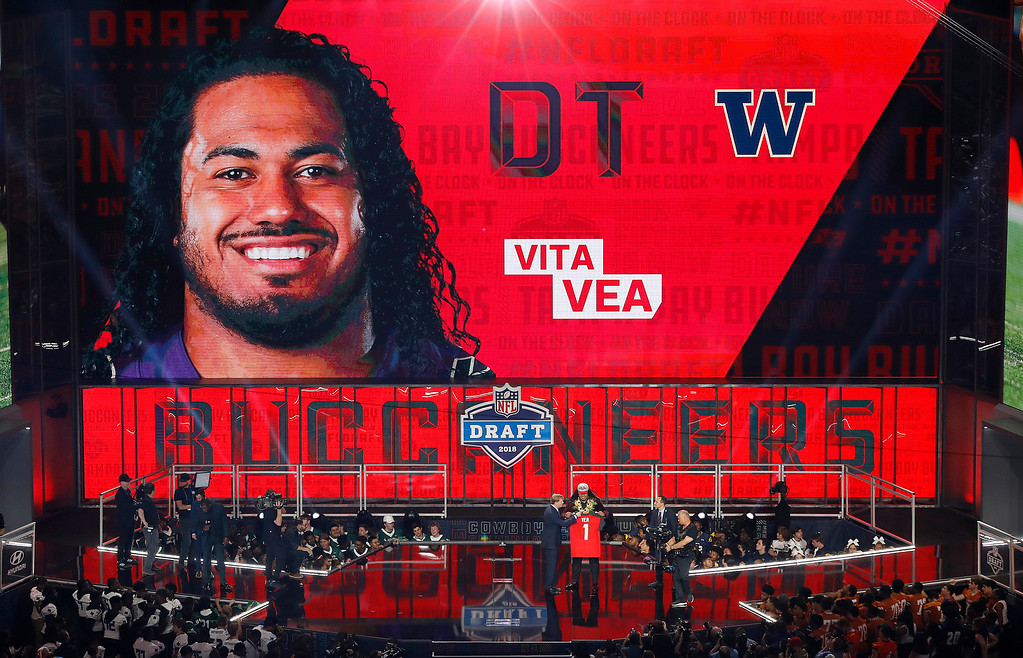 . Commissioner Roger Goodell presents Washington\'s Vita Vea with his Tampa Bay Buccaneers jersey during the first round of the NFL football draft, Thursday, April 26, 2018, in Arlington, Texas. (AP Photo/David J. Phillip)