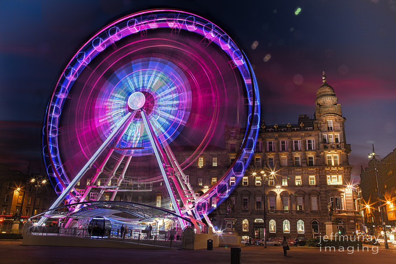 The Wheel of Glasgow - or Glasgow Eye.  I promised a night shot back when I posted this of the square and wheel http://www.flickr.com/photos/jrmurray/6914663185.  This was one of the most outstanding sunsets I have seen in a long while and I was excited to get three decent captures in the one night, yesterday's shot, this and another of the Gallery (to follow).  This is a three shot HDR, I was lucky for the wheel to stop while I was capturing the normally exposed frame - so I overlayed that frame to get the detail of the boxes.  5D3 gismodo update :  http://gizmodo.com/5889707/canon-eos-5d-mark-iii-video-chompin-darkness-slaying-digital-single-reflex-camera-pr0n-bring-it