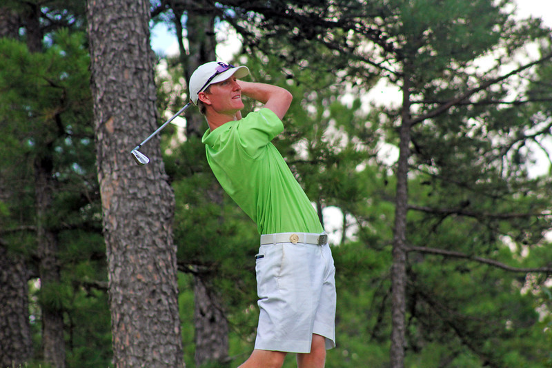 Jordan Niebrugge of Mequon, WI watches his tee shot from the sixth hole fall more than 150 feet to the green during the second round of the 2013 Western Amateur at The Alotian Club in Roland, AR. (WGA Photo/Ian Yelton)