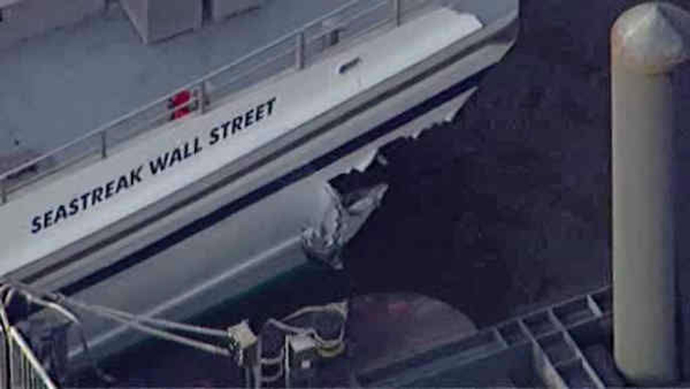 . This aerial photo provided by WABC News Channel 7 shows damage to a commuter ferry in Lower Manhattan, Wednesday, Jan. 9, 2013, in New York. The Fire Department says at least 50 people were injured when a ferry from New Jersey struck a dock during rush hour. (AP Photo/WABC News Channel 7)