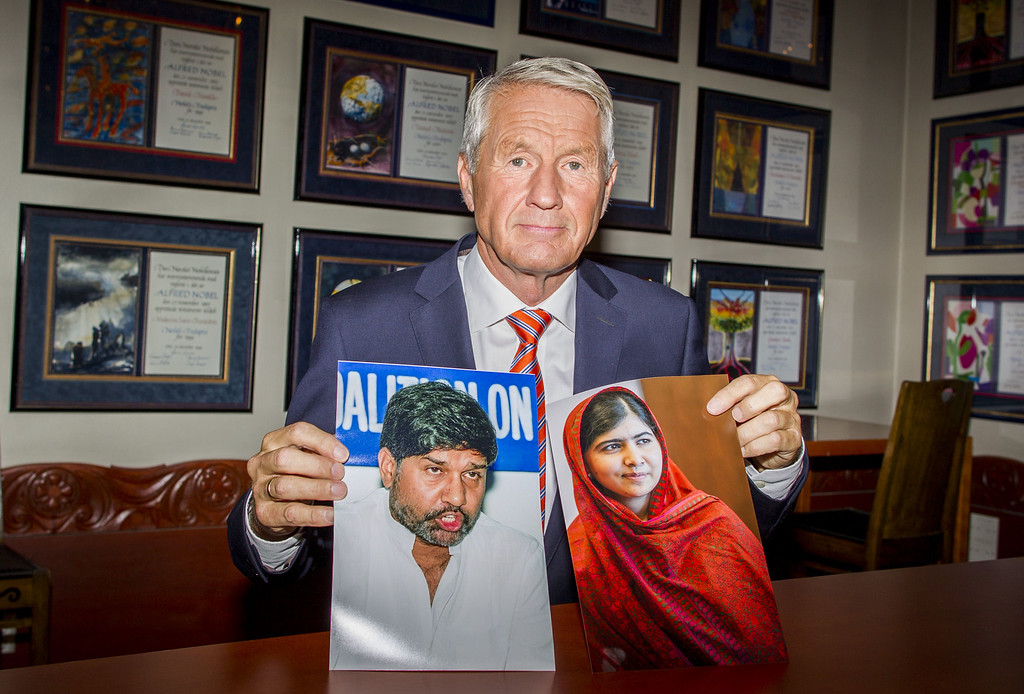 . The chairman of the Norwegian Nobel Committee, Thorbjorn Jagland, poses with pictures of Pakistani education activist Malala Yousafzai (R) and Kailash Satyarthi (L), Indian anti-child labour activist, who have been awarded the Nobel Peace Prize 2014 at the Nobel Institute in Oslo on October 10, 2014. AFP PHOTO / NTB SCANPIX / VEGARD WIVESTAD GROTT /AFP/Getty Images