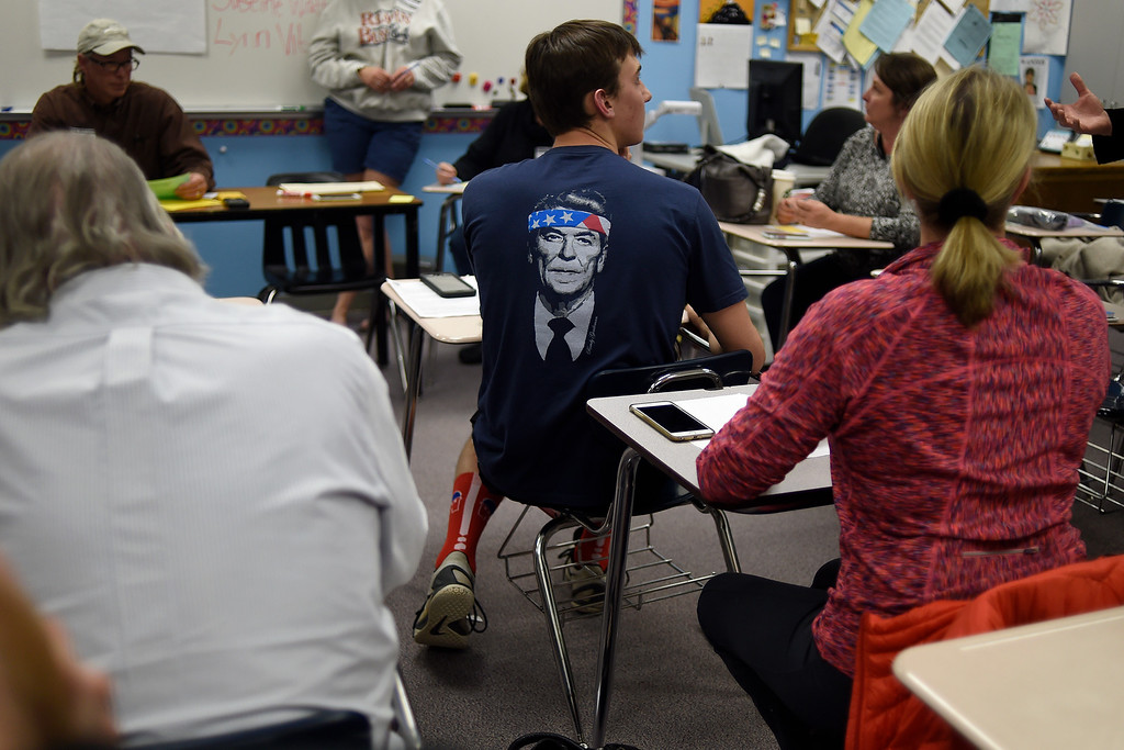 . Teclan Watts rocks a Ronald Reagan T-shirt as republicans caucus at Columbine High School on Tuesday, March 1, 2016. (Photo by AAron Ontiveroz/The Denver Post)