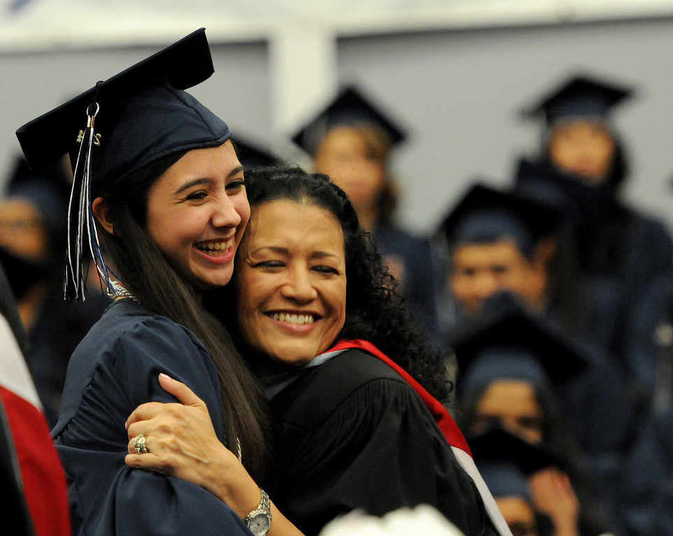 . School Principal Nidia E. Castro poses for a photo with a student  at Northridge Academy High School during the graduation ceremony on Thursday, June 5, 2014. (Photo by Dean Musgrove/Los Angeles Daily News)