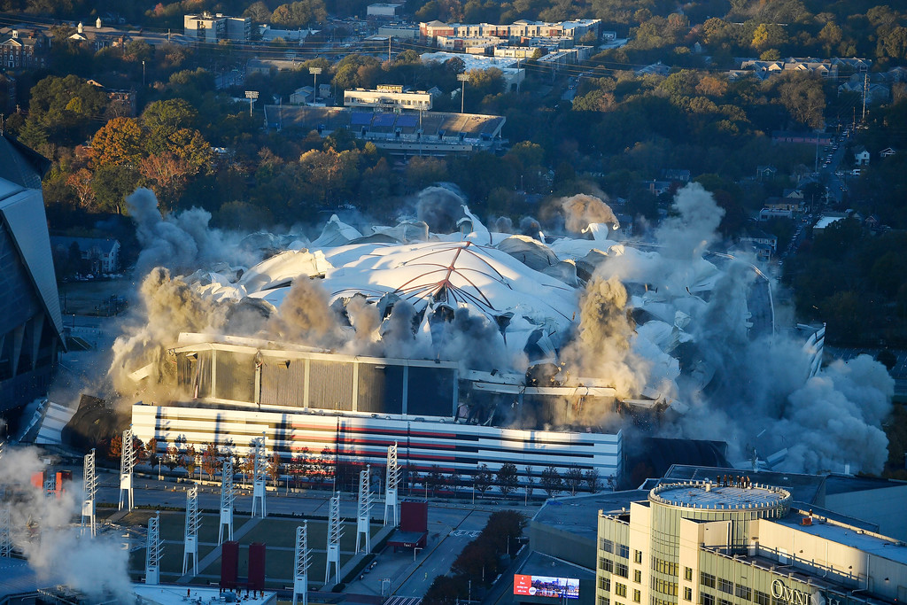 . The Georgia Dome is destroyed in a scheduled implosion Monday, Nov. 20, 2017, in Atlanta. The dome was not only the former home of the Atlanta Falcons but also the site of two Super Bowls, 1996 Olympics Games events and NCAA basketball tournaments among other major events. (AP Photo/Mike Stewart)