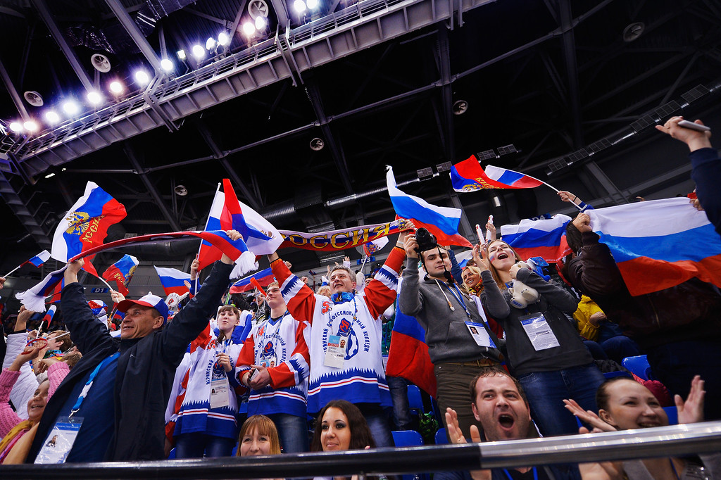 . Russian spectators cheer during the Ice Sledge Hockey Preliminary Round Group B match between the United States of America and Russia during day four of Sochi 2014 Paralympic Winter Games at Shayba Arena on March 11, 2014 in Sochi, Russia.  (Photo by Dennis Grombkowski/Getty Images)