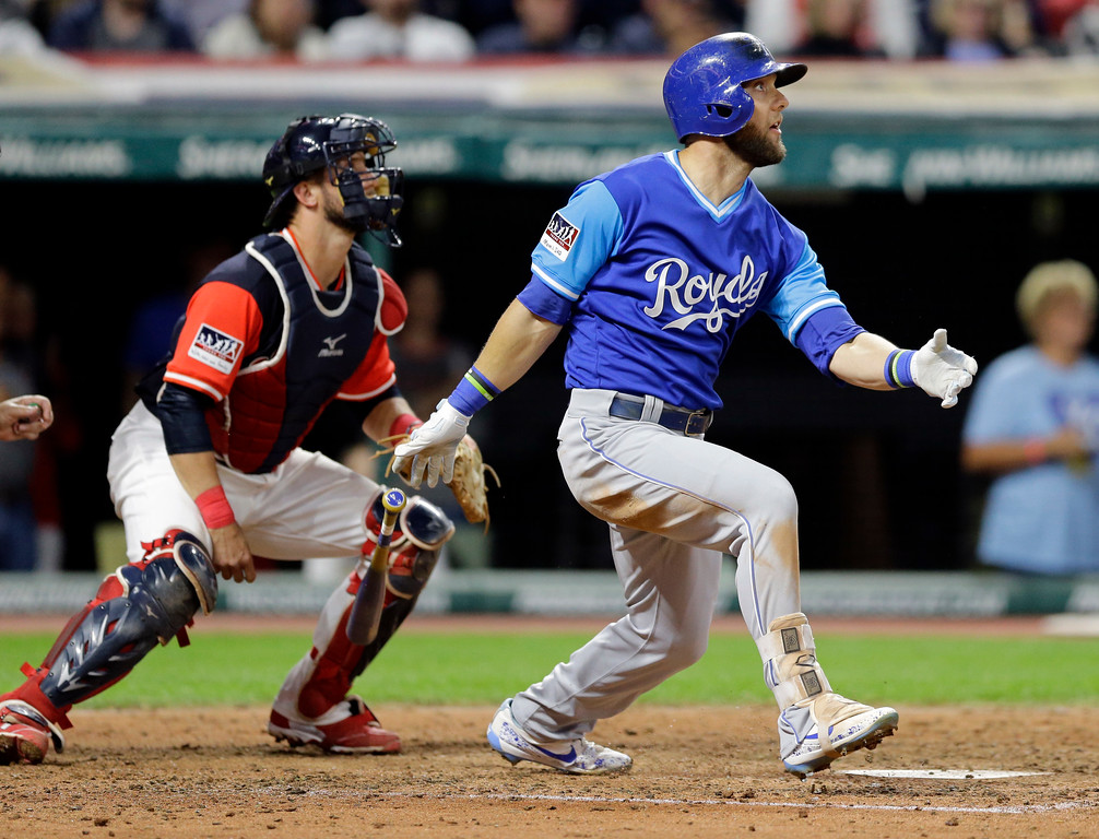 . Kansas City Royals\' Alex Gordon watches a single off Cleveland Indians starting pitcher Ryan Merritt during the seventh inning of a baseball game, Friday, Aug. 25, 2017, in Cleveland. Indians catcher Yan Gomes watches. (AP Photo/Tony Dejak)