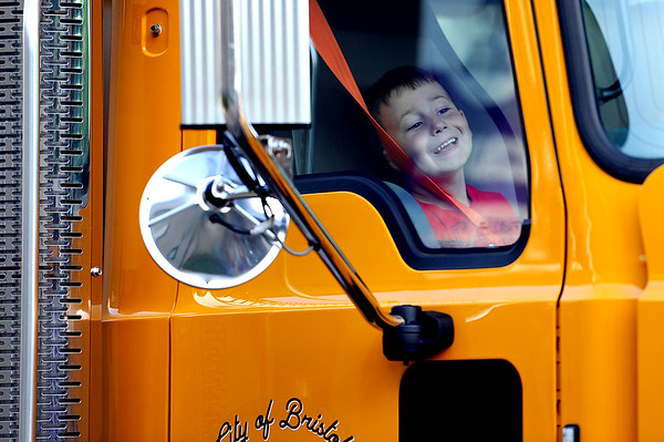 9/3/2019 Mike Orazzi | Staff Caleb Nass while getting a ride from Public Works to the West Bristol School on the first day of school Tuesday morning in Bristol.
