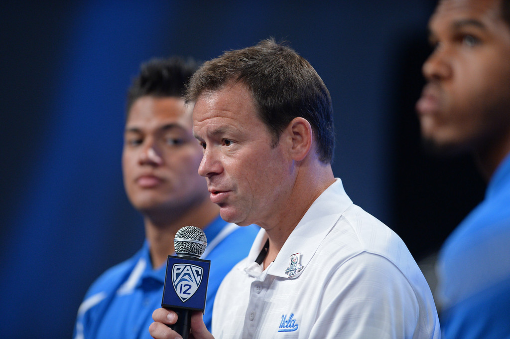 . UCLA Coach Jim Mora. Pac12 media Day at Sony Studios.  Photo by Brad Graverson 7-26-13