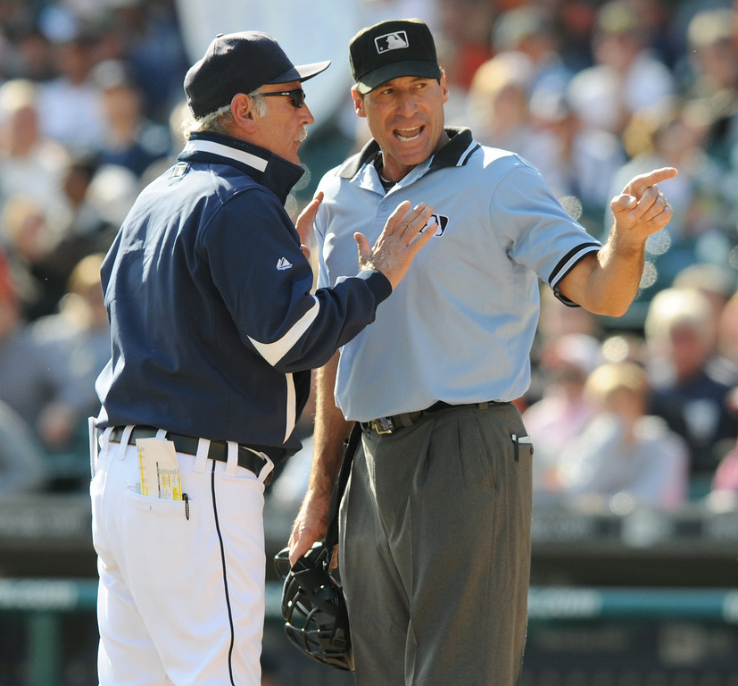 . Detroit Tigers Manager Jim Leyland, left, is ejected from the game by home plate umpire Angel Hernandez in the bottom of the eighth inning against the Minnesota Twins.  The Twins beat the Tigers, 8-3.  Photo taken on Thursday, October 1, 2009, at Comerica Park in Detroit, Mich.  (The Oakland Press/Jose Juarez)