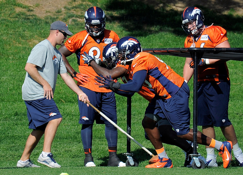 . Denver Broncos outside linebacker Shaun Phillips (90) runs through dills during practice September 9, 2013 at Dove Valley. (Photo by John Leyba/The Denver Post)