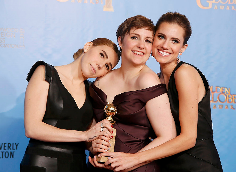 ". ""Girls\"" creator and actress Lena Dunham (C) poses with cast members Allison Williams (R) and Zosia Mamet (L) after \""Girls\"" won the award for Best Televison Series, Comedy or Musical at the 70th annual Golden Globe Awards in Beverly Hills, California January 13, 2013. REUTERS/Lucy Nicholson"